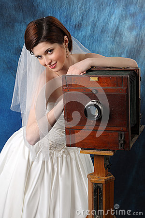 Charming bride with an old camera