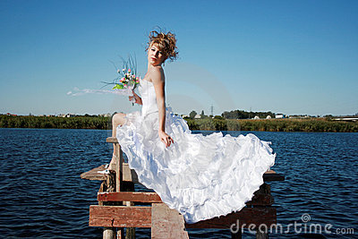 Charming bride relaxing on the sun