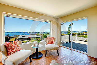 Charming bright living room with walkout deck and amazing window