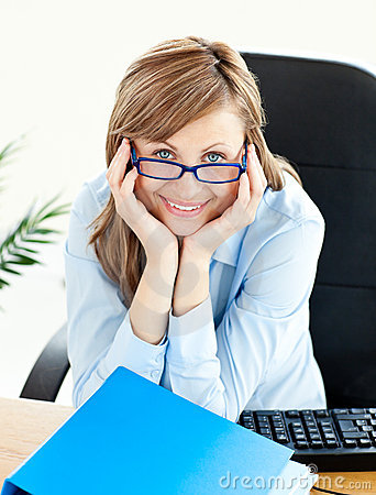 Charming businesswoman smiling sitting at her desk