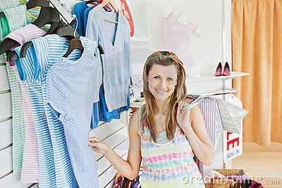 Charming caucasian woman doing shopping smiling