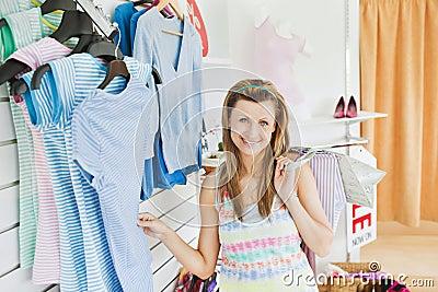 Charming caucasian woman doing shopping smiling