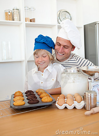 Charming father and his son baking at home