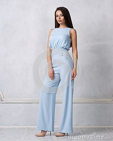 Free Charming Female Model In Blue Jumpsuit Stock Photo - 111945390