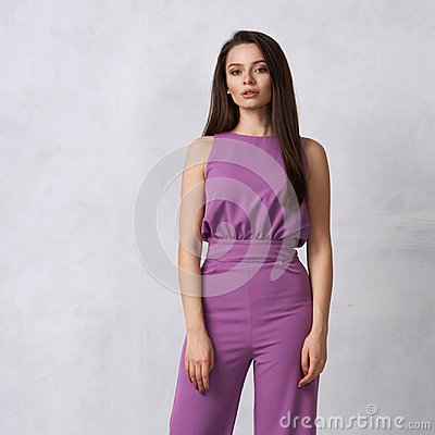 Free Charming Female Model In Purple Jumpsuit Stock Images - 118430954