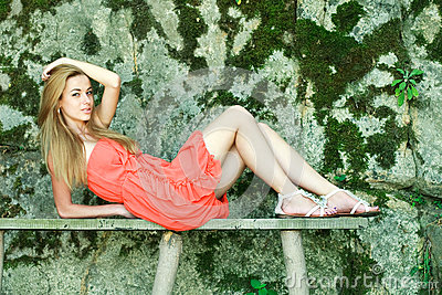 charming girl  lying on a wooden bench