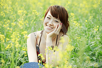 Charming girl in rape field