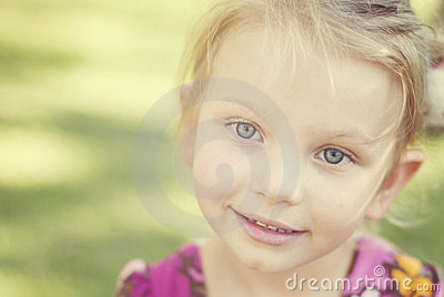 Charming little blue eyes girl with dreamy look