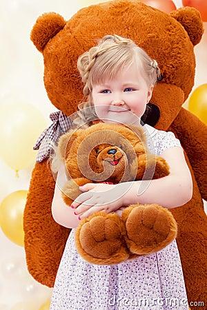 Charming little girl hugging favorite toy