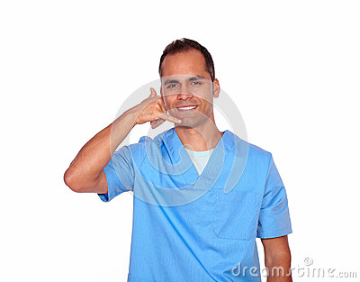 Charming male nurse gesturing call me with hand
