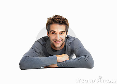 Charming man lying on floor with arms crossed