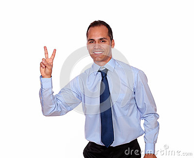 Charming man smiling and showing you victory sign