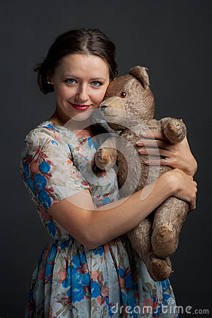 Charming young girl holding teddy bear
