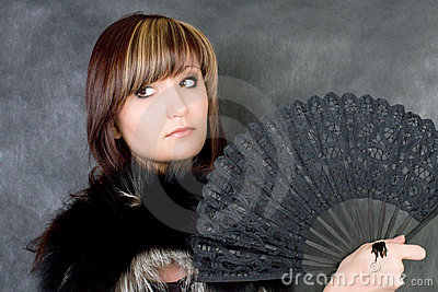 Charming young woman with italian fan
