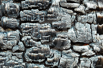 Charred wooden wall after fire