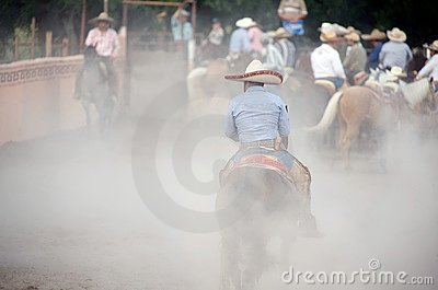 Charros Mexican horsemen in dusty arena, TX, US Editorial Photo