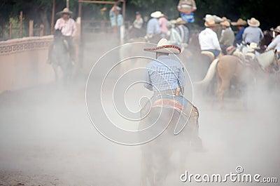 Charros Mexican horsemen in dusty arena, TX, US Editorial Photo