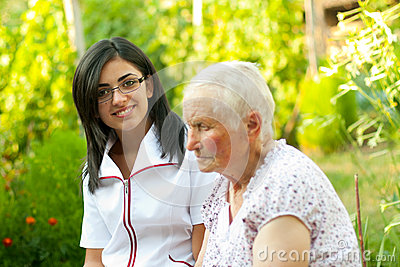 Chatting with sick elderly woman