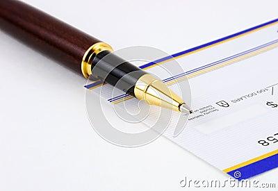 Closeup of pen on check