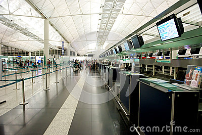 Check-in counter at airport Editorial Photo