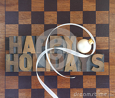 Checkerboard with happy holidays and ornament