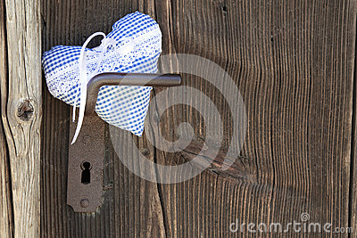 Checkered blue/white heart shape hanging on door handle or a woo