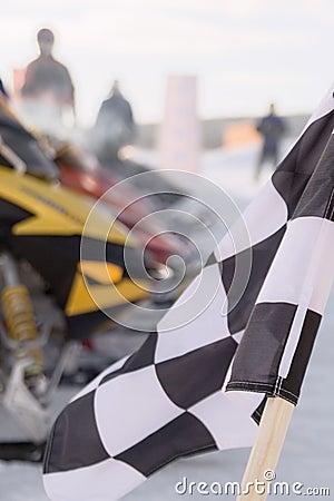 Checkered flag snowmobile race