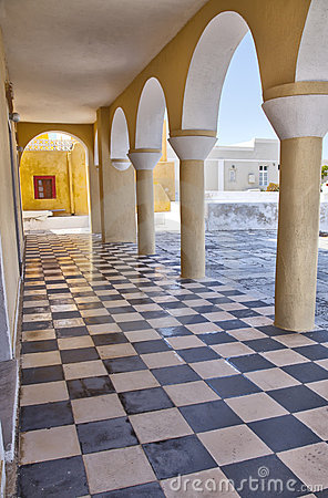 Checkered floor and arches in Santorini church