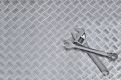 Checkerplate and wrenches background
