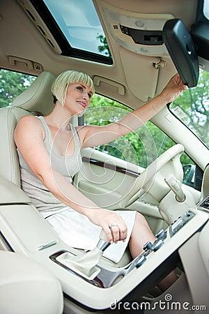 Checking rear view mirror