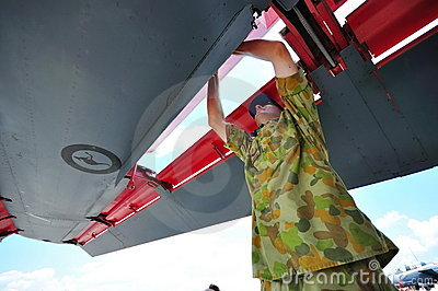 Checking wing of F-111 at Singapore Airshow Editorial Stock Photo