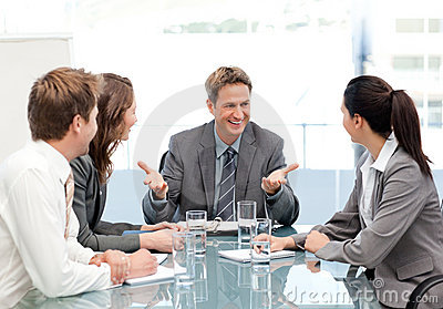 Cheeful manager talking to his team at a meeting