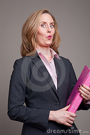 Cheeky businesswoman with pink folder