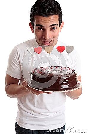 Cheeky man with a birthday cake