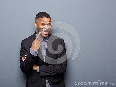 Cheerful african american business man pointing finger