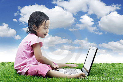 Cheerful Asian girl with laptop