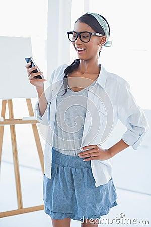 Cheerful attractive artist text messaging