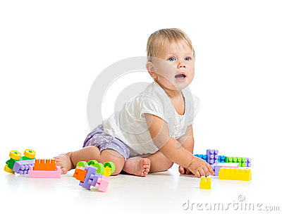 Cheerful baby playing with construction set