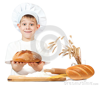 Cheerful baker boy with a loaf of rye bread
