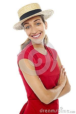 Cheerful baker woman wearing straw bowler hat