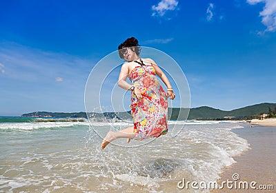 Cheerful beach jump