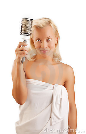 Cheerful blonde combs hair