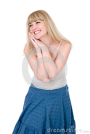 The cheerful blonde with hands on a cheek