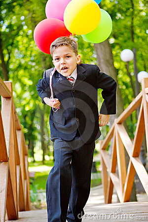Cheerful boy with balloons