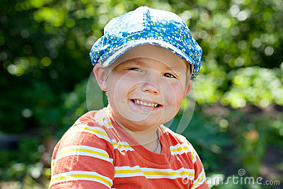 Cheerful boy in a cap
