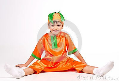 Cheerful boy in carrot fancy dress