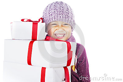 Cheerful boy and Christmas gifts isolated in white