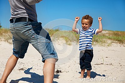Cheerful Boy Looking Excited Together with Dad