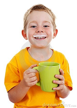 Cheerful boy with milk mustache