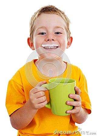 Cheerful boy with milk mustache